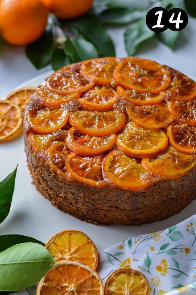 finished orange cake on a white plate with orange slices