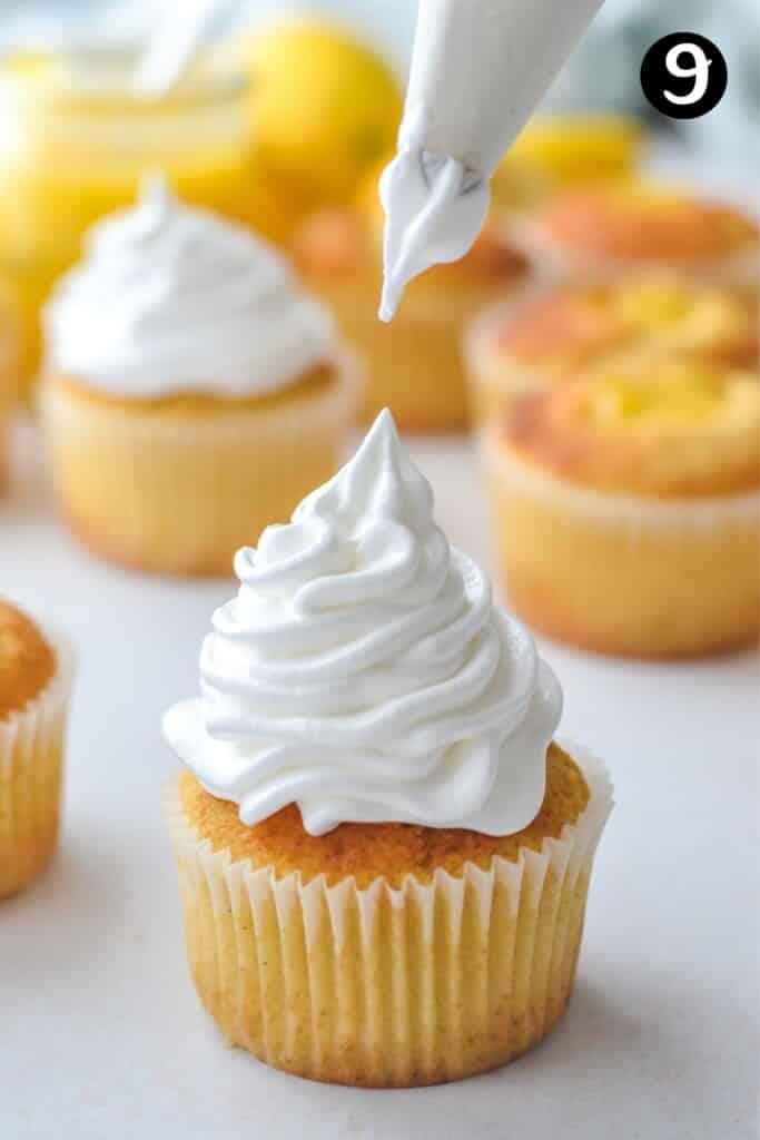 a piping nozzle piping meringue onto a cupcake
