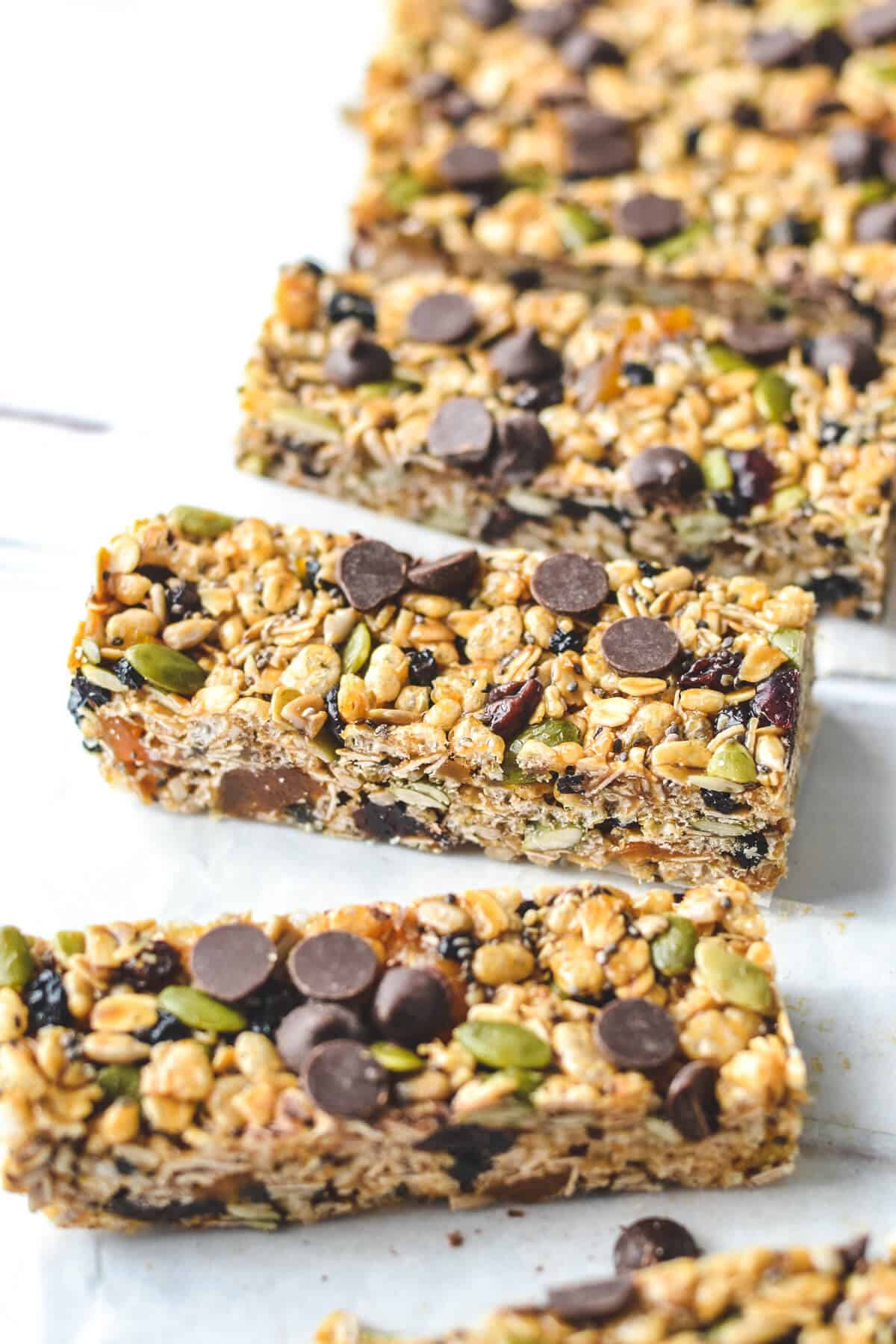 a row of muesli bars on a wooden board