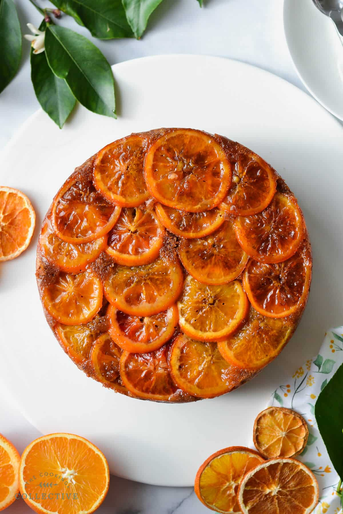 finished orange drizzle cake on a white plate