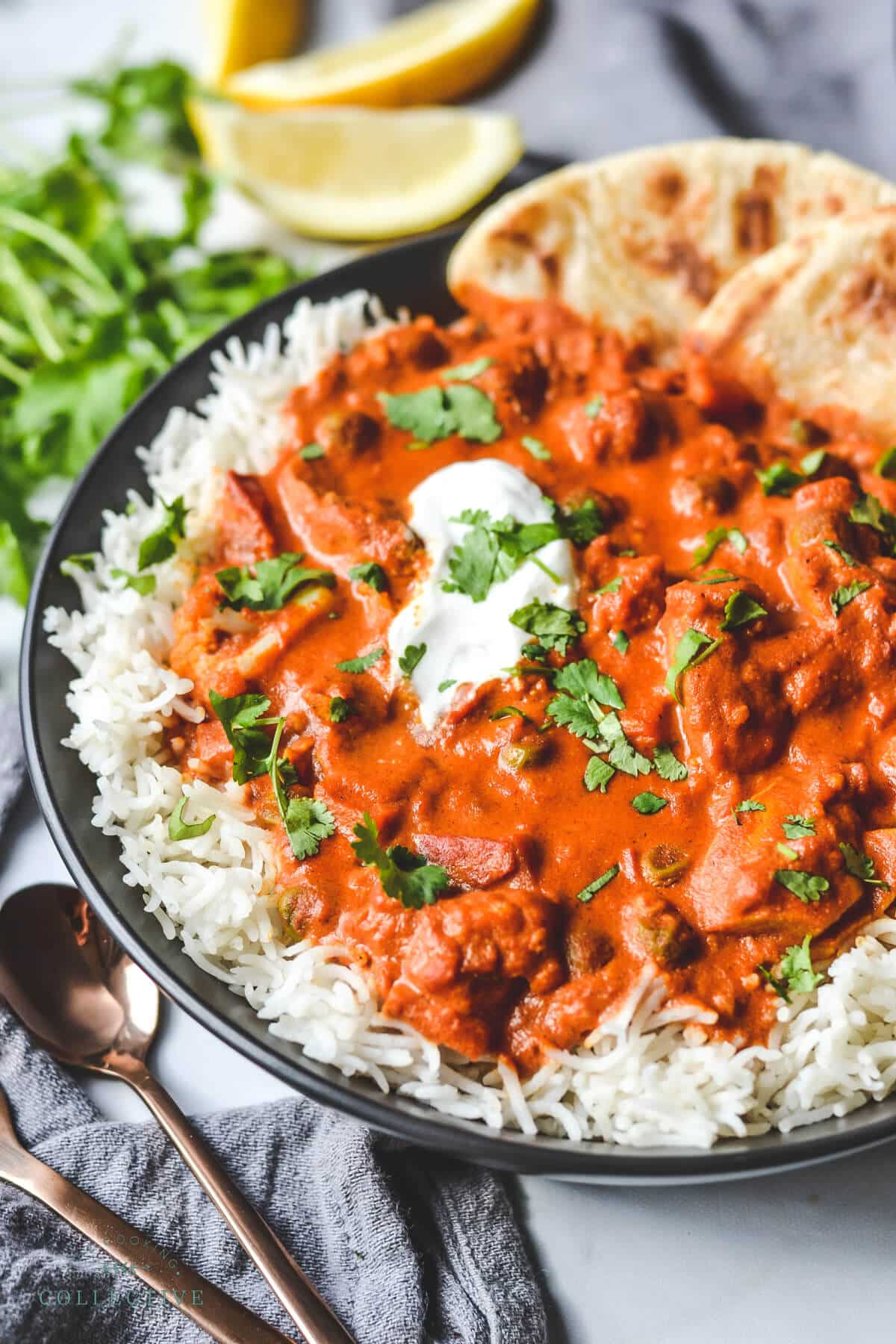 finished chicken tikka masala served over rice in a black bowl