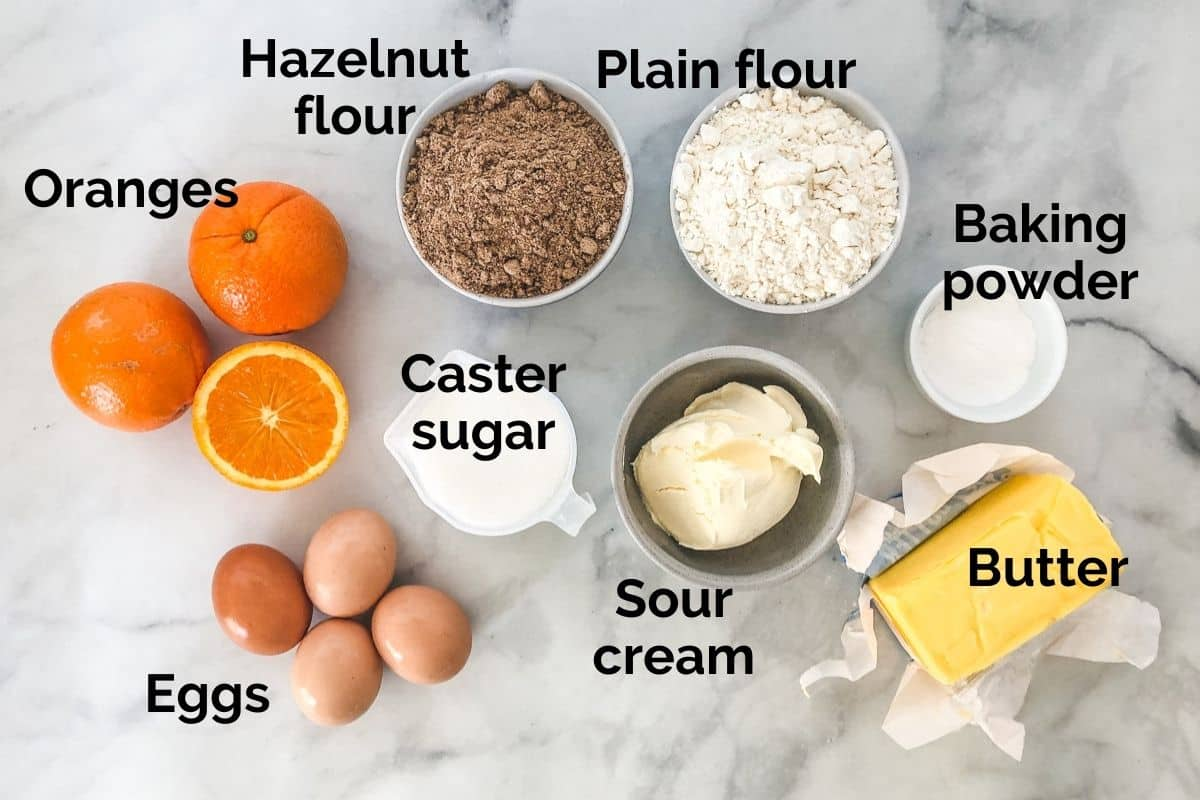 all ingredients for orange syrup cake laid out on a table