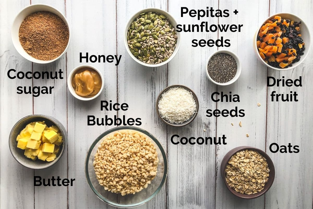 all ingredients for homemade muesli bars laid out on a table