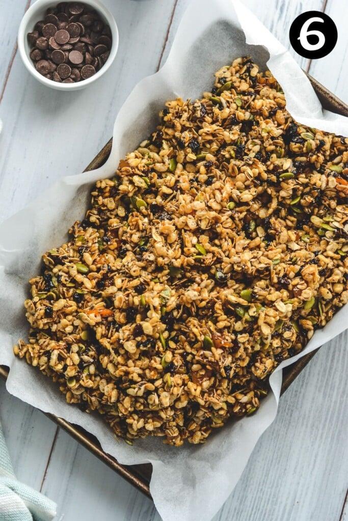 muesli bar mixture piled in a baking tin