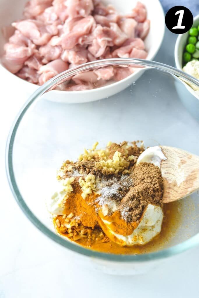 tikka masala marinade ingredients in a glass bowl