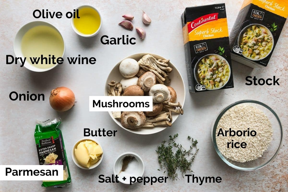 all ingredients for mushroom risotto laid out on a table