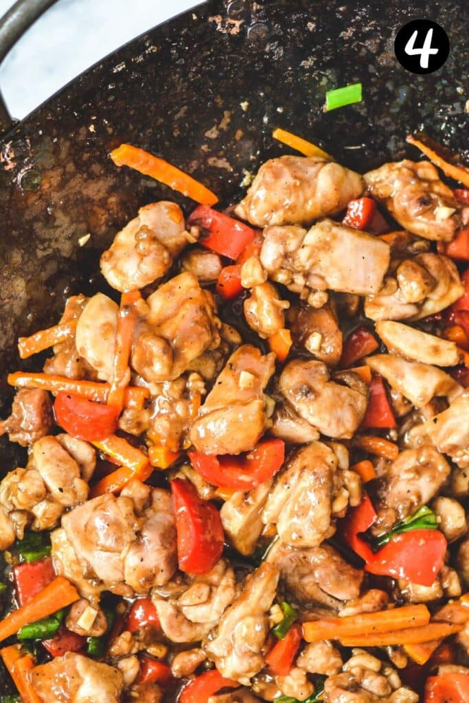 finished chicken and cashew stir fry in a wok