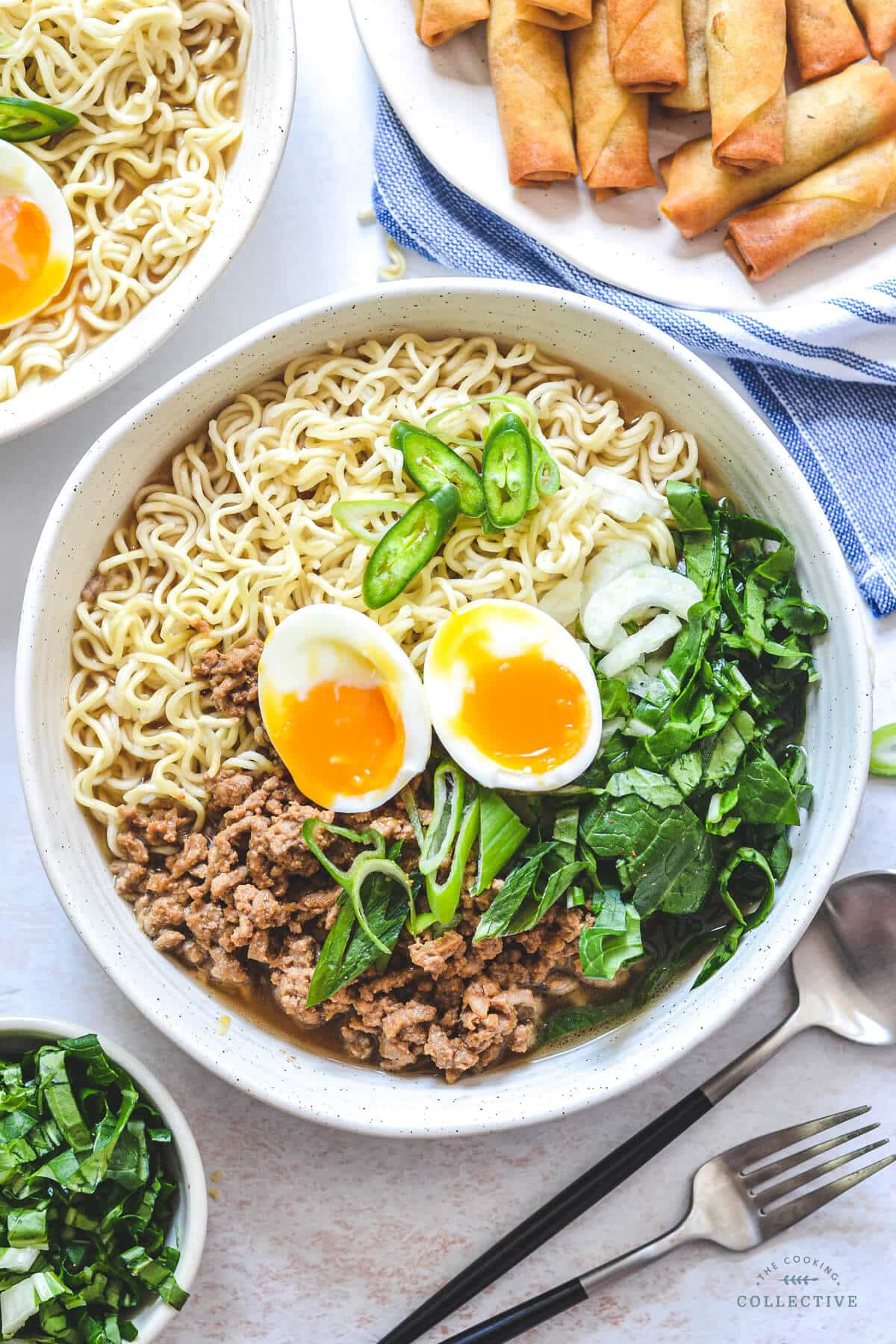 top view of a bowl of ramen soup topped with pork mince and runny eggs