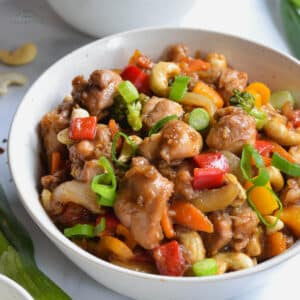 chicken and cashew stir fry in a white bowl