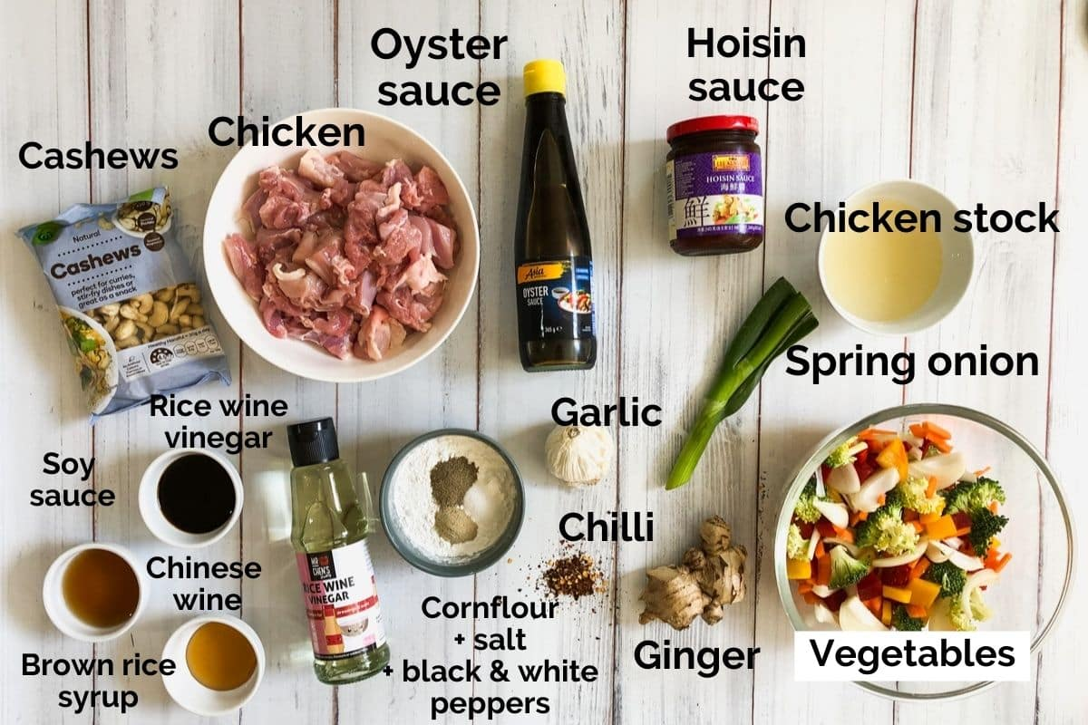 all ingredients for chicken and cashew stir fry laid out on a table