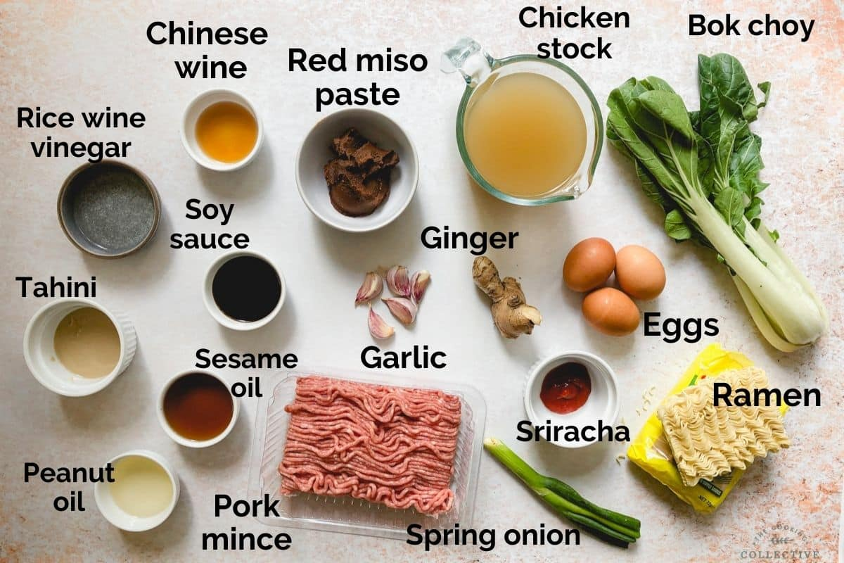 all ingredients for miso pork ramen laid out on a table